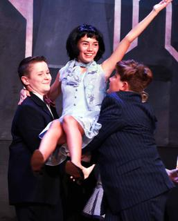 Henry Spragens and Cody Ballard give Elizabeth Morris (starring as Millie) a lift in the musical production of 'Thoroughly Modern Millie' at Kentucky Classic Arts on Aug. 7.  The youth cast for Kentucky Classic Arts' production of 'Thoroughly Modern Millie' took the stage at Centre Square Aug. 8-11, and the adult cast will continue to delight audiences Aug. 15-18. 'Thoroughly Modern Millie' tells the story of a small-town girl, Millie Dillmount, who comes to New York City to marry for money instead of love – a thoroughly modern aim in 1922, when women were just entering the workforce. For tickets, go to www.kentuckyclassicarts.com or you can buy tickets at Farmers National Bank on Main Street in Lebanon or at the Lebanon Tourist and Convention Commission on Spalding Avenue.