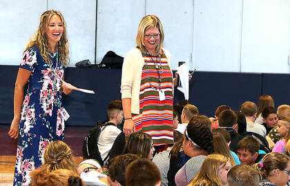 Marion County Middle School teachers Sara Buckman and Kim Wright mingle with students on the first day of school.
