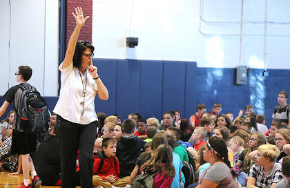 Marion County Middle School Principal Buffy Mann instructs students to be quiet while announcements are being made on the first day of school.