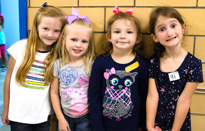 Addi Kelly, Raylee Abrams, Haley Tolliver and Liz Harris are learning the hallway procedures at Glasscock Elementary School.