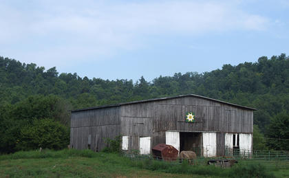"""Eula Ray and Sonny Kirkland's barn quilt, """"Kirkland Star,"""" is displayed on a old barn that's nestled into the countryside on Hw   y. 337 in Gravel Switch."""