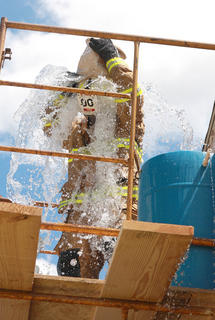 At the conclusion of the bucket brigade race, Loretto Fire Chief Tommy Hamilton cooled off by dumping the last bucket on himself.