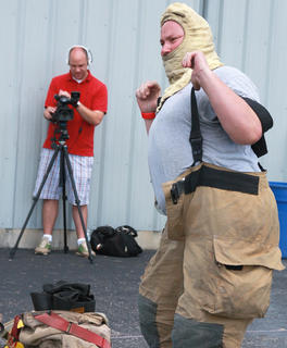 In a new event this year, Mike Mullenhour of the Loretto Fire Department races to put on his gear as quickly as possible.