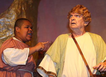 Snug, played by Jeremiah Jackson, and Peter Quince, played by Lynn D. Farris, is one of the six tradesmen who perform a play, which Quince himself authored for the Duke Theseus and his wife Hippolyta at their wedding.