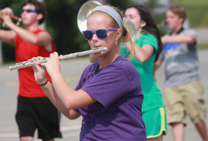 Kelsey Hamilton works on  keeping pace while carrying her flute.