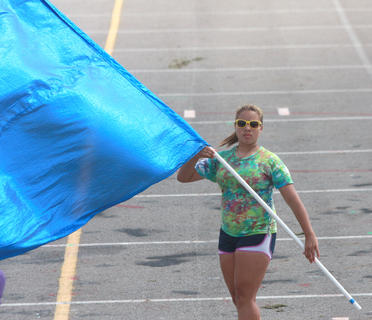 Megan Newton of the color guards works on her place in the formation.