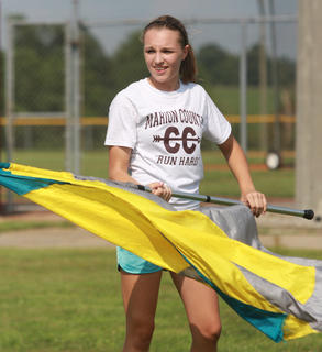 McKenna Bartley practices her flag routine.