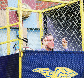 Principal Paul Terrell goes down in the dunk tank.