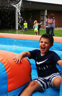 Grayson Barrett is all smiles on the slip-n-slide.