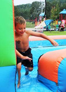 Daxton Terrell loves the slip-n-slide.