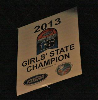 The state championship banner hung above the court as the Lady Knights defeated the Notre Dame Lady Pandas.