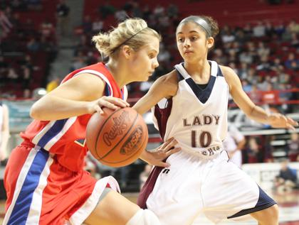 Haeli Howard applies defensive pressure to a Lincoln County player in the semifinals.