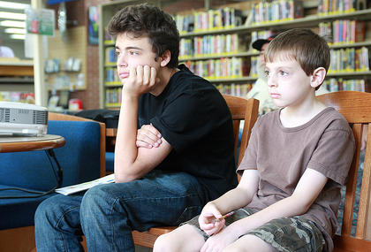 Bill Feese, left, and Caleb Brown are focused on Kurt Mattingly's presentation about creating and editing videos in iMovie.