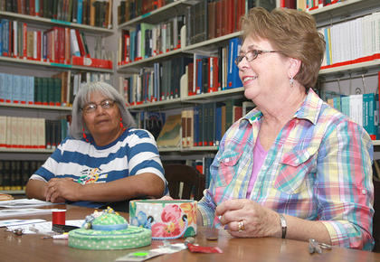 Joyce Flowers, left, listens to Martha Potter, who spoke about sewing.