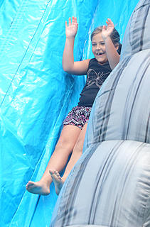 Audrey Kessler, 8, makes one of many trips down the bouncy slide.