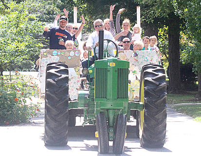 A wagon full of visitors come to the end of a hayride at the Loretto Motherhouse.