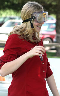 Kaitlyn Baker of Louisville tries her hands (or motor skills) against a set of goggles that impairs a person's vision.