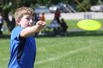 Eli Nelson, 9, plays disc golf during Family Fitness and Safety Day.