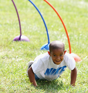 Antonio Douglas, 6, does pushups during the Marion County High School ROTC obstacle course at Family Fitness and Safety Day Saturday at Graham Memorial Park.