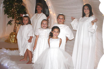 Scene 7: Heaven – Angels greet the people who are allowed into Heaven. The angels are, from left, Lexi Osbourne, Anne Faye Rakes, Laurel Cochran, Maddie Spalding, Aubrey Osbourne and Abbe Goss.