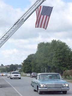 The Loretto Fire Department used a ladder truck to hang an American flag over Danville Highway near the location where Rakes was killed.