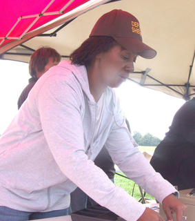 Cindy Hawkins of the Marion County Sheriff's Office helps register riders.