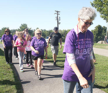 Walkers make their way around the track at Graham Memorial Park.