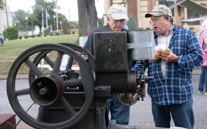Harold Lawson of Danville, left, chats with Steve Gibson of Mt. Sherman about Gibson's 2 1/2 horsepower Foos gas engine on Saturday morning.