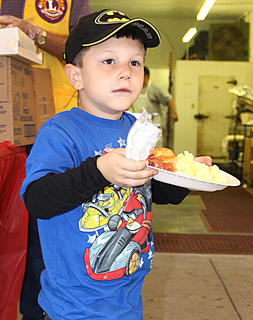 "Ayden ""Huckleberry"" French, 5, of Louisville is ready to eat."