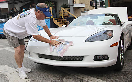 Steve Conley of Louisville shines his Corvette. This is his first year at the State Farm Insurance, Erica Barnes, Car, Truck and Motorcycle Show.