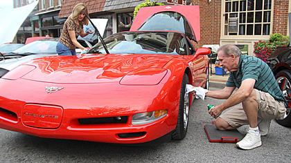 Donna and Jim Richardson of Jeffersontown shine their 2003 Corvette. This is the third year they have participated in the State Farm Insurance, Erica Barnes, Car, Truck and Motorcycle Show.