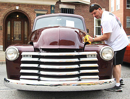 Gary Franklin of Shepherdsville puts some final touches on his 1949 Chevy truck. This is his eighth year at the car show.
