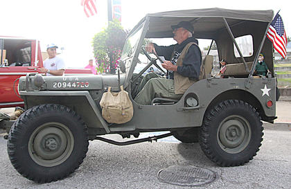 Ron Carey of Junction City backs his 1952 Willys M38 military jeep into place. This is a Korean War era jeep.