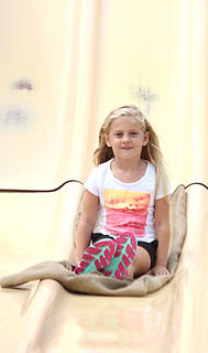 Madelyn Howard, 6, nears the bottom of the big slide on Sunday afternoon.