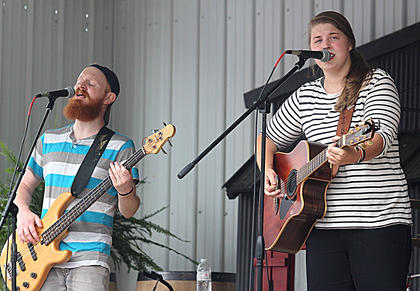 Eric Scott sings back-up and plays bass as Allison Stafford provides lead vocals for No Deceit on Sunday afternoon on the Maker's Mark/Kentucky Cooperage Main Stage.