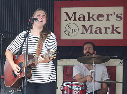 Allison Stafford sings lead vocals for No Deceit with drummer Bryce McDaniel behind her Sunday afternoon on the Maker's Mark/Kentucky Cooperage Main Stage.