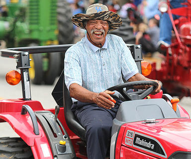 Ike Calhoun drives a tractor in the Pigasus Parade.