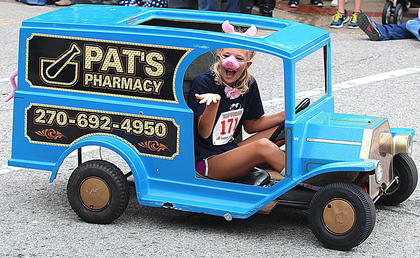 Kelli Jo Johnson blows a kiss to the crowd Saturday afternoon during the Pigasus Parade.