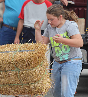 Abby Clark throws her way to a win in the girls division of the hay bale toss.