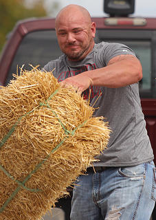 John Reed puts his might into a throw in the men's hay bale toss.