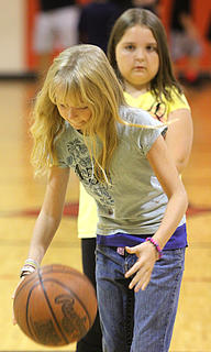 Autumn Brady of Lebanon dribbles before taking a shot in the free throw contest Saturday morning. Kaylee Wathen of New Haven waits behind her.