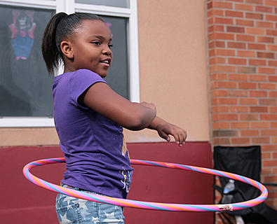 Deona Shively works to keep her hula hoop up during the 7-9-year-old contest at St. Augustine.