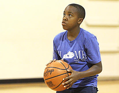 Javon Adams prepares to shoot in the free throw contest Saturday at St. Augustine. Adams made four of his five free throws.