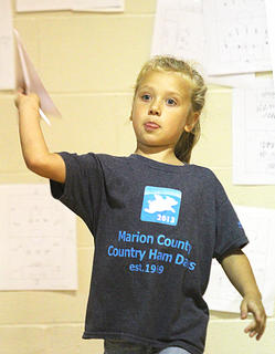 Marley Stout of Lebanon takes a turn in the paper airplane throwing contest Saturday at St. Augustine.