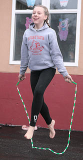 Ellie Buckman of Lebanon jumps rope Saturday morning in the kids games at St. Augustine.