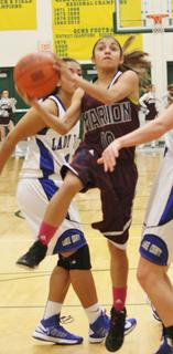 Haeli Howard drives through the lane for a shot during the regional championship win over Larue County.