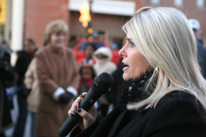 Marion County Chamber of Commerce Executive Director Stacey Mattingly welcomes the crowd at Dickens Christmas Nov.26.