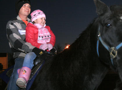 Brooklyn DeVerney, 3, of Raywick and her father, William, enjoy a horse ride at Dickens Christmas.