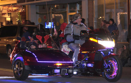The Dickens Christmas parade included some luminous motorcycles.