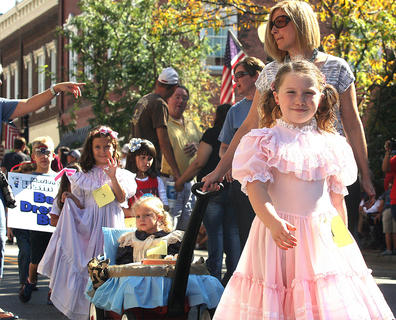 Jenna Mullins, front, prepares to strut her stuff during the children's parade. Also pictured are Adalyn Higdon, Katie Zink and Blake Wise.